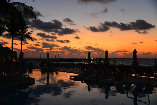 Playacar Palace: Sunrise by the pool