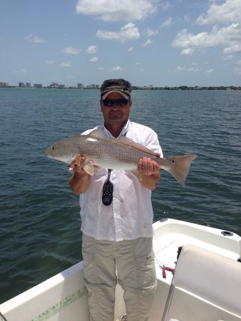 Fishing Sarasota Florida - Day Tours: Captain Charlie and a red fish