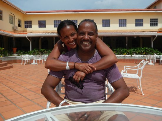 Grenadian by Rex Resorts: Happy husband & wife hanging out under the hot sun!