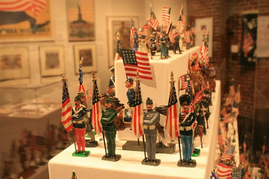 Frazier History Museum: An exhibit of antique flag holders.