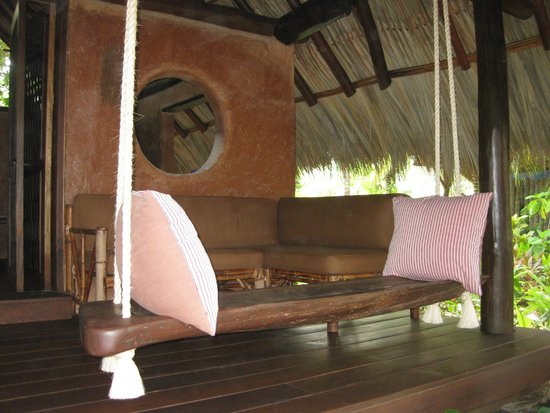 Casa Viva Troncones: front porch of square casita with open air window