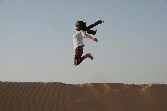 Emirates Tours and Safaris: jump over a sand dune