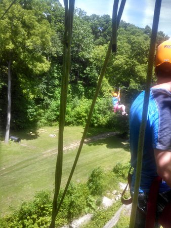 Sky Tours at YMCA Union Park Camp: Someone taking off from the tower over a meadow