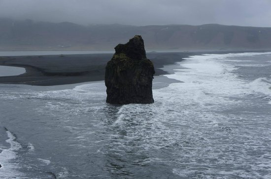 Black Sand Beach: Rock pillar by the beach.