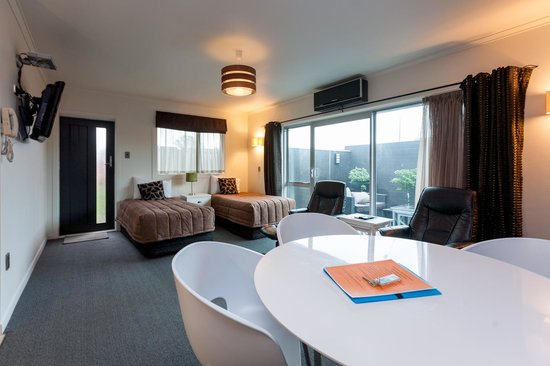 The Strand: One Bedroom Unit - Single Beds in the Lounge