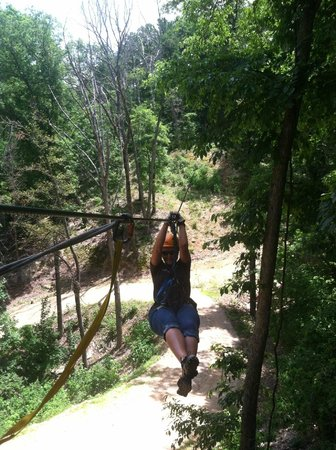 Ozark Mountain Ziplines: Coming in on one of the training lines.