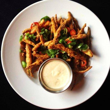Rain Restaurant & Bar: Crispy okra fries, scallions, chiles, spiced yogurt dipping sauce.