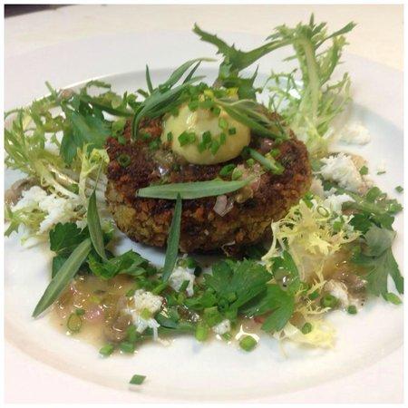 Rain Restaurant & Bar: Crispy pork cheeks, capers, sauce gribiche, egg yolk, frisee, tarragon.