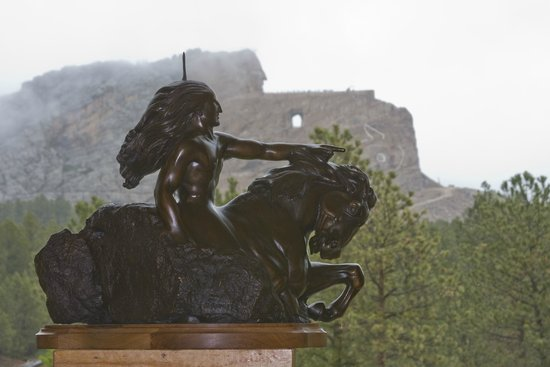 Crazy Horse Memorial: Our view of Crazy Horse behind a replica at guest services.
