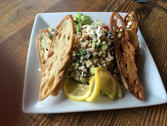 The Bread Peddler: Greek Salad with crispy toasts and slices of bread