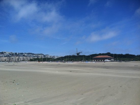 Ocean Beach: Looking back towards the western end of Golden Gate Park at the windmills.