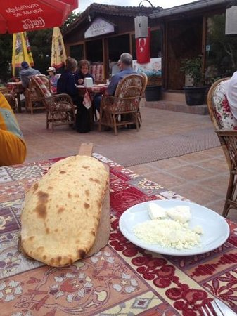 Anatolian Kitchen: fresh warm bread and local butter on the pati