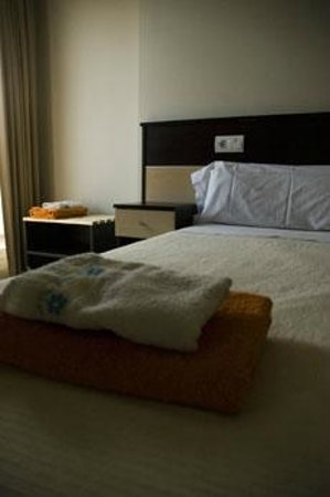 HotelMR: Detalle de habitación cama de matrimonio