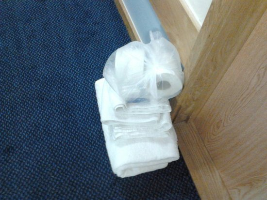 Travelodge Gatwick Airport Central: The cleaners left towels on floor outside room. Note the toilet role in a protective bag for hyg