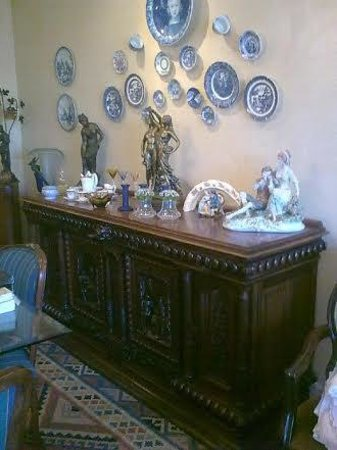 Stadium Guest House: The Late 19th Century Flemish Walnut sideboard in the dining room of Stadium