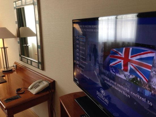 Hilton Rome Airport Hotel: Big TV with interactive features.