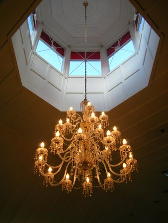 Real Journeys - TSS Earnslaw Vintage Steamship Cruises : Chandelier in the main dining room at Walter Peak.