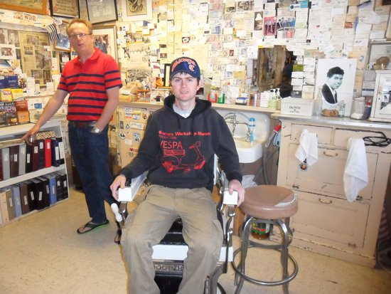 Angel & Vilma Delgadillo's Route 66 Gift Shop & Visitor's Center: me sat in famous barbers chair!