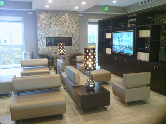 Holiday Inn Austin Airport : Smart TV with info/ seating area