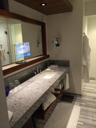 Fairmont Pacific Rim : Bathroom, note the TV inside the mirror