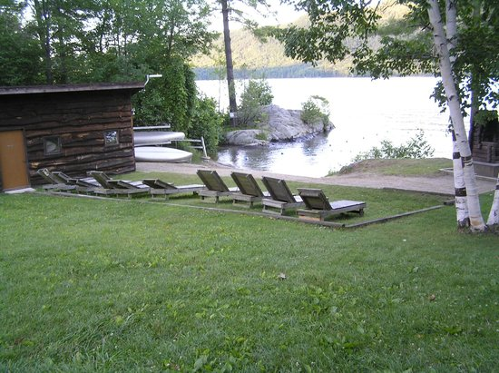 Northern Lake George Resort: Protected beach/bathing area and boathouse