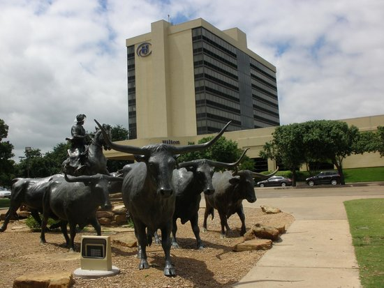 Hilton Waco: Hilton exterior. The monument commemorates the riders who crossed the River Brazos over the year