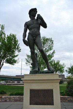 Michelangelo's David replica: statue and sign