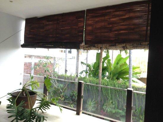 Danoya Villa - Private Luxury Residences: living room falling apart curtain