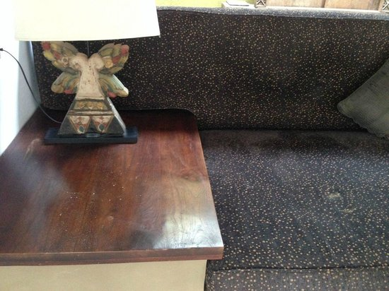 Danoya Villa - Private Luxury Residences: dusty sofa and unclean table