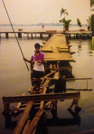 Boy fishing at West Lake at dusk
