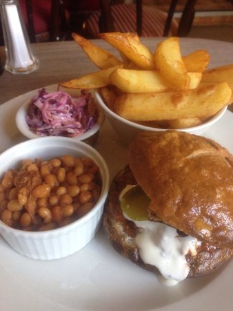 The Feathers Inn: Pulled pork sandwich in toasted brioche bun, sour cream,coleslaw, chunky chips and chilli baked