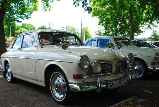 OURWAY Tours in Stockholm: Leisure park with a parked antique Amazon Volvo
