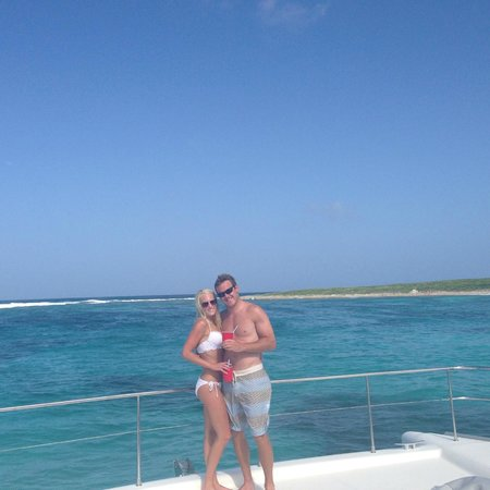 Private Yacht Charter SXM - Day Trips : Us on the front of the boat