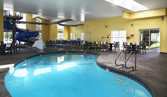 Indoor Pool And Slide Picture Of Ramada By Wyndham Spokane