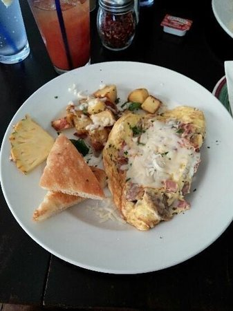 Fabiani's Bakery and Pizza: Italian Mmmmmeat Omelet with fresh breakfast potatoes and homemade focaccia.