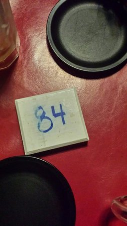 Bianchi's Pizza: Wooden order number!