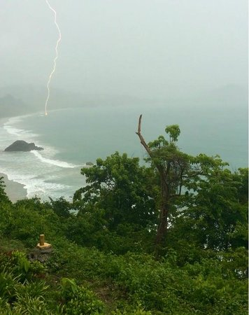 Arenas del Mar Beachfront & Rainforest Resort: View of lightning from our balcony.  My son took this pic with his phone.  (Not photoshopped.)