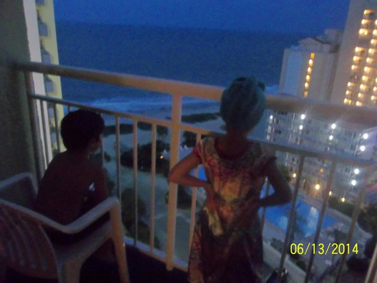 Coral Beach Resort & Suites : Enjoying the night view from our Ocean View room balcony!
