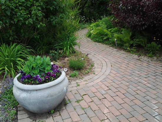 Just for You B&B: Beautiful stone pathways with casually landscaped plantings to give an old garden appeal.