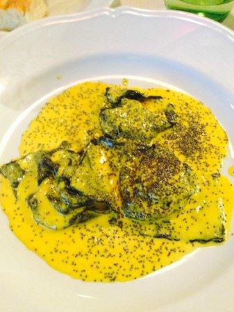 Il Solferino: Homemade ravioli filled with fish in saffron souce