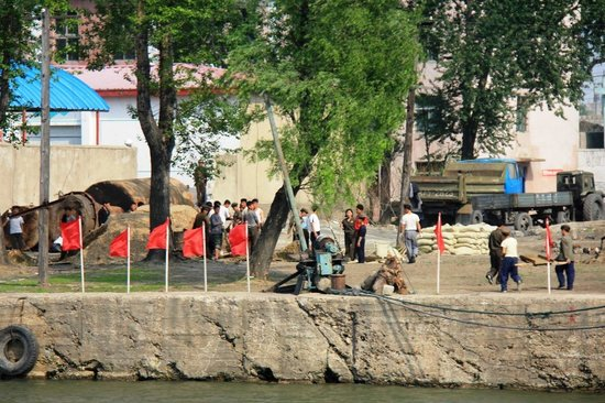 China and North Korea Friendship Bridge: Dandong Yalu River - North Korea lifestyle