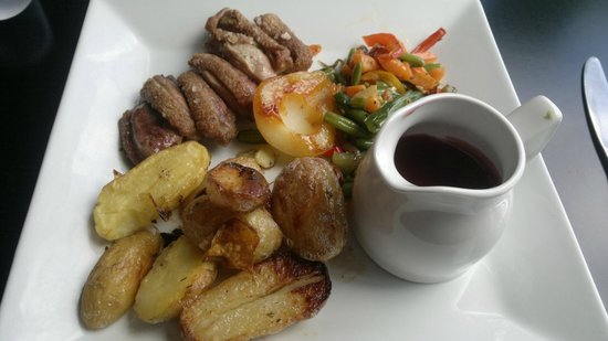 Marco Polo: Pan-fried duck, honeyed lemon, butter potatoes and red-wine sauce.