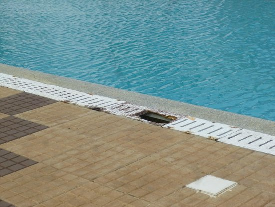 Backwater Ripples: Rotten pool grille around pool
