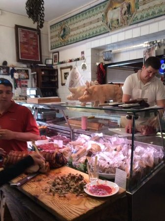 Tuscan Wine Tours by Grape Tours : Getting ready to have lunch at the CRAZY butcher's place!