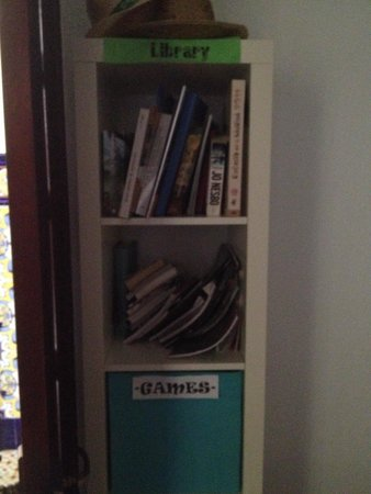 The Cathedral Hostel: Games and library shelf