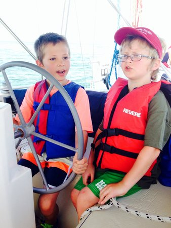 Orange Beach Sailing Charters and Sunset Cruises: Helping drive the boat!