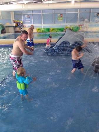Seashore Holiday Park - Haven: Kids inside pool with water fountain and slide. Wee man loved it!