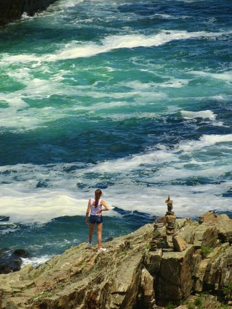 Cliff House: granddaughter walking on the rocks ...taken from my room
