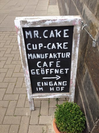 Mr. Cake Cologne: Look for this sidewalk sign to help find the unexpected entrance.