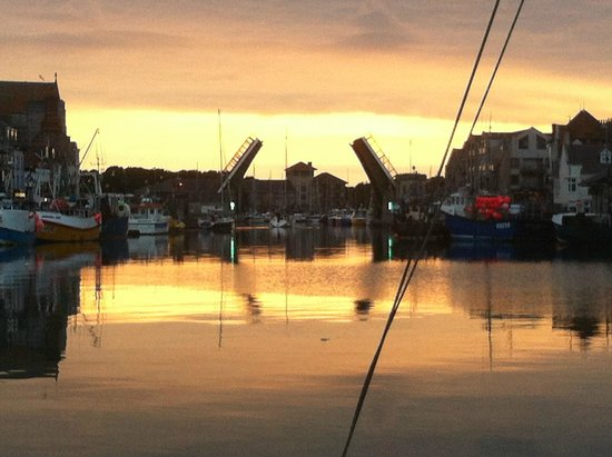 The Sandcombe: sunset on the harbour